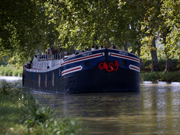 The 4-passenger Deluxe hotel barge Alegria, cruising on the historic Canal du Midi