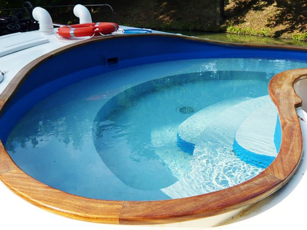 Relax in the large heated pool while cruising on the Alegria