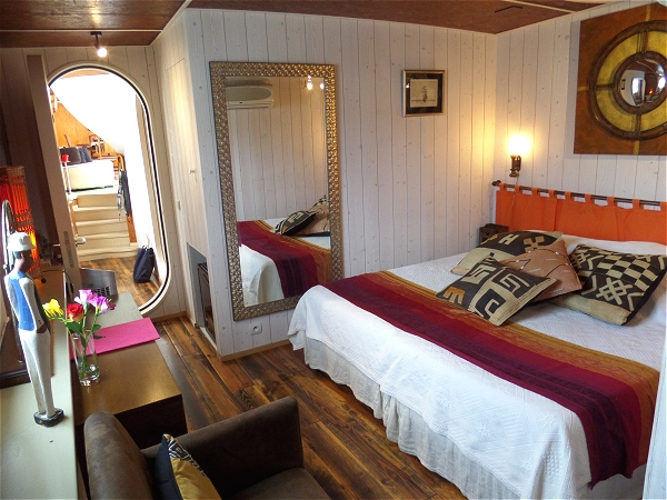 The Rive Droite cabin, shown above and below, aboard the Alegria<br>  can be configured with king or twin beds