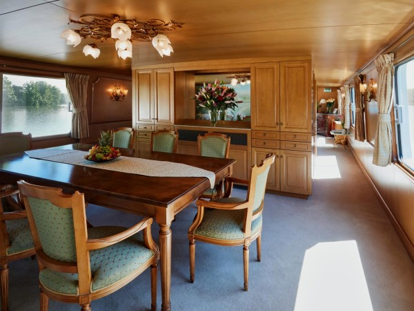 The dining room aboard the Amaryllis is beautifully set for every meal