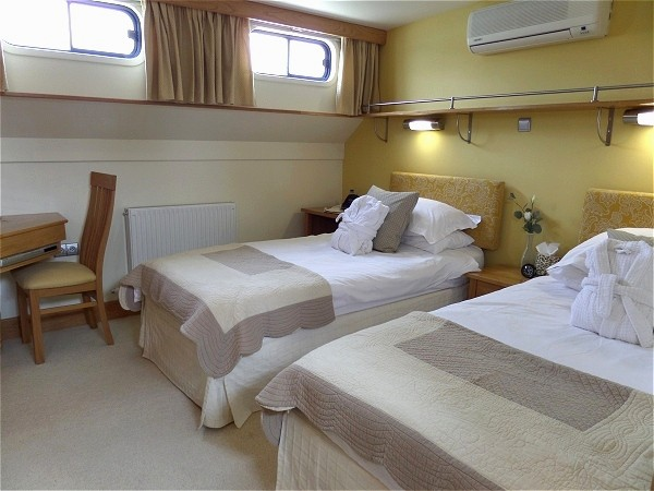 The cabins aboard the Apres Tout offer either king or twin accommodations<br> along with luxurious bedding