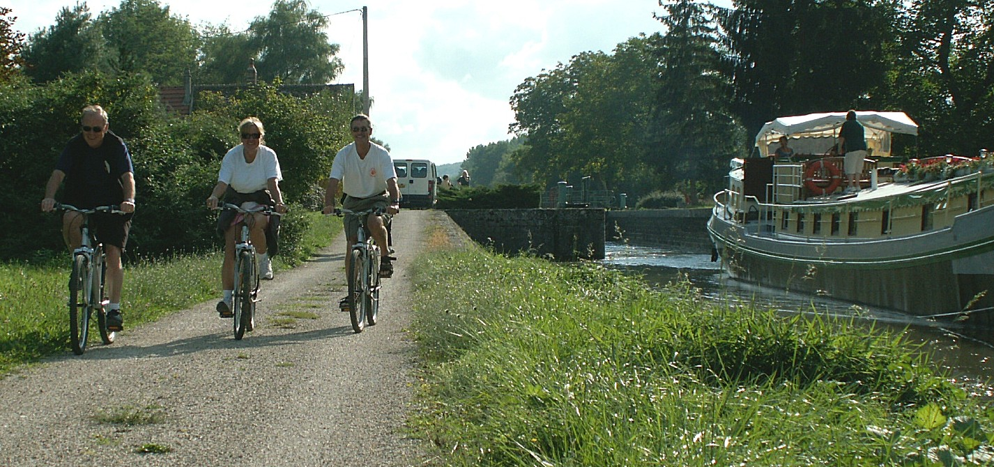 Barge Guests Cycling on the Canal du Nivernais, in France.   Barge Cruises, Canal Cruises, River Cruises in France, and the Rest of Europe,  for an All-Inclusive Week of Adventure, Relaxation,  Gourmet Cuisine and Wines, Excursions