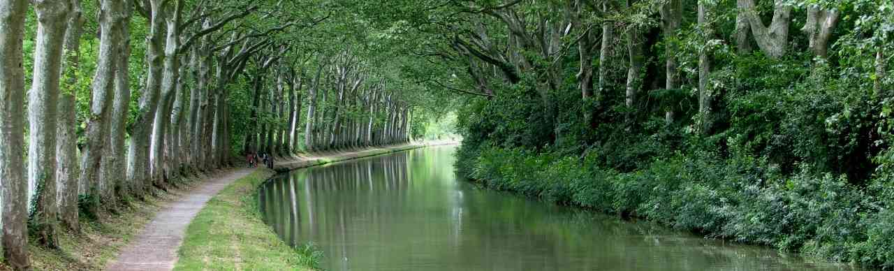 Listing of Barge Cruises, By Region. Pictured here is the beautiful and tranquil Canal du Midi in the South of France