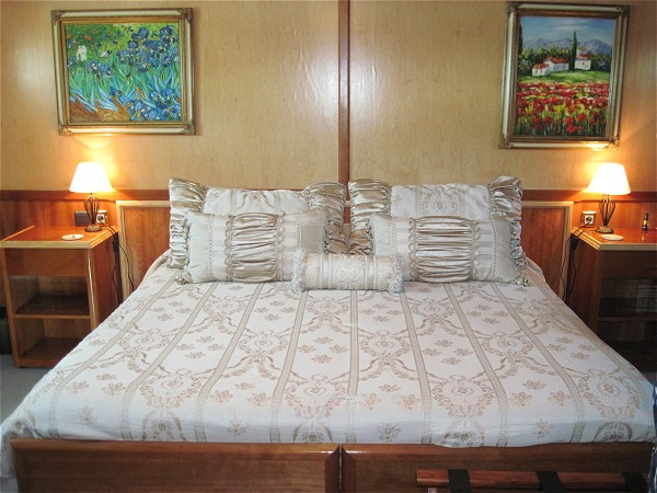 Each large, spacious cabin offers luxurious bedding and can be configured as either king or twin beds