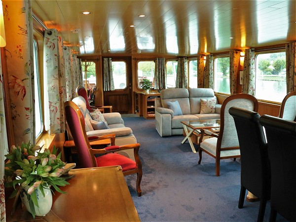 The lovely salon aboard the C'est la Vie offers plenty of comfortable seating