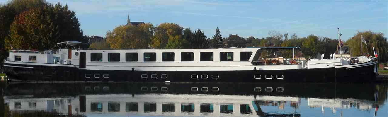 Listing of Barge Cruise Special Offers. Pictured here is the 8-passenger CestLaVie, cruising in Burgundy and Champagne.