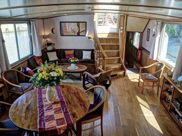 The comfortable salon and dining area aboard the Claire de Lune