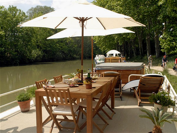 The spacious sundeck on the Clair de Lune, a great place to relax under shade or in the spa tub