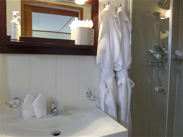Each cabin aboard the Colibri has its own beautiful and modern ensuite bathroom with shower
