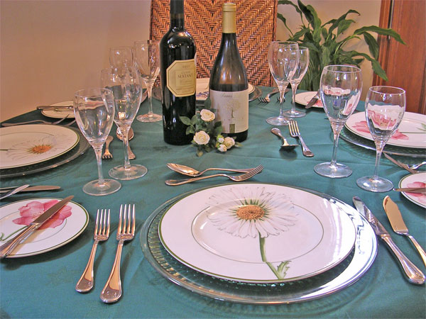 Dining table aboard Colibri set for dinner.