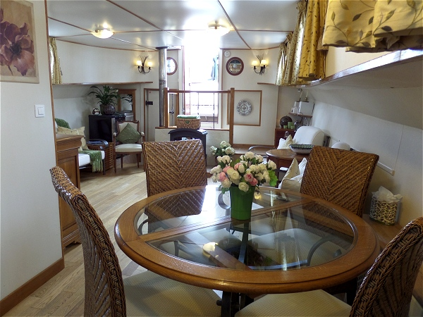 The light and airy salon and dining area aboard the Colibri