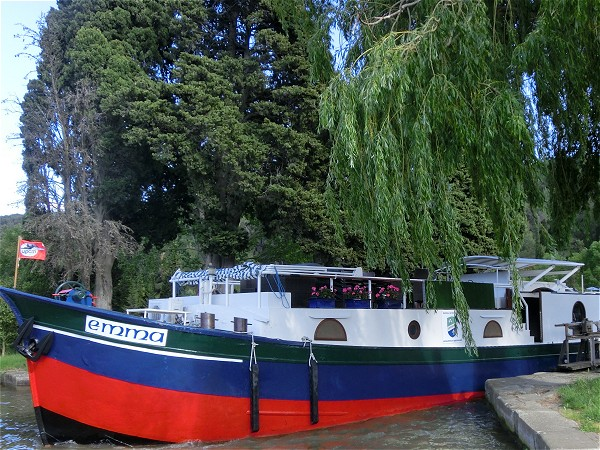 The 6-passenger First Class hotel barge Emma cruising along the Canal du Midi