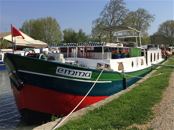The hotel barge Emma moored in Capestang, a quaint village along the Canal du Midi