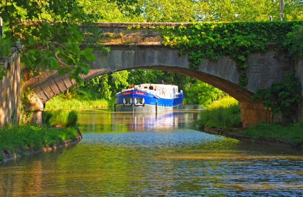 The Ultra Deluxe 8-passenger barge Enchante cruising along the Canal du Midi