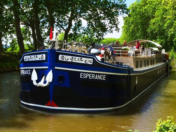 The Deluxe 6-passenger barge Esperance cruising on the Canal du Midi