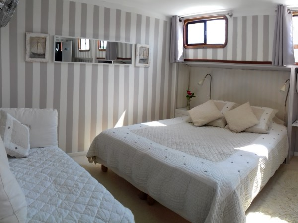 The Farigola Suite (mid-ship) can be configured with a queen or 2 twin beds