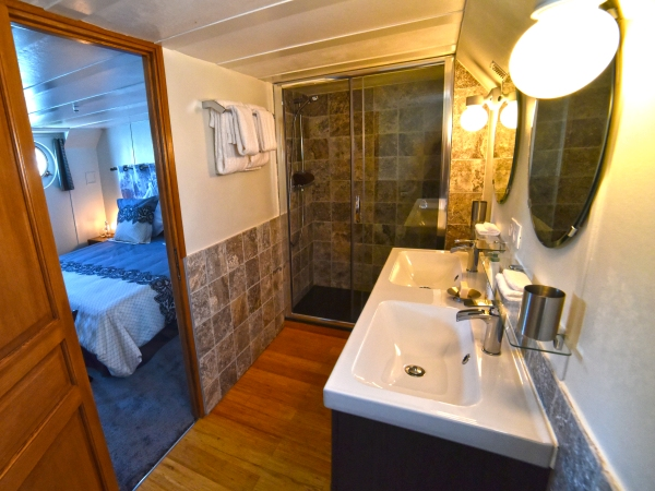 The ensuite bathrooms aboard the Finess have double sinks and spacious walk in showers