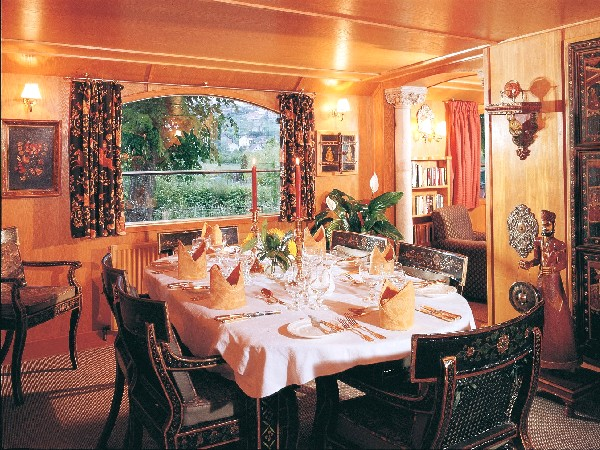 The dining room aboard the Fleur de Lys is elegantly set for your meals each day