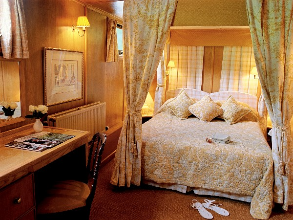 The cabins aboard the Fleur de Lys offer either king or twin canopied beds