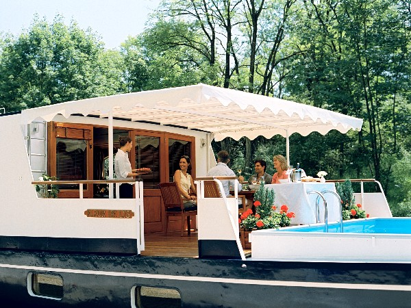 The canopied sundeck and refreshing pool aboard the Fleur de Lys offer cool and relaxing days