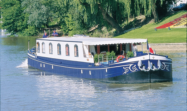 The 6-passenger ultra deluxe Hotel Barge Fleur de Lys, cruises in Burgundy.