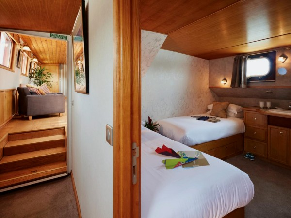 Hirondelle has one fixed twin cabin shown above, one fixed queen cabin<br>and two cabins that can be configured with queen or twin beds.