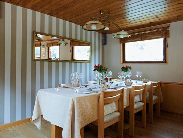 The dining room aboard the Hirondelle is beautifully set for every meal