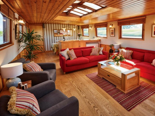 The comfortable and roomy salon aboard the Hirondelle with large picture windows<br> offers plenty of room to relax