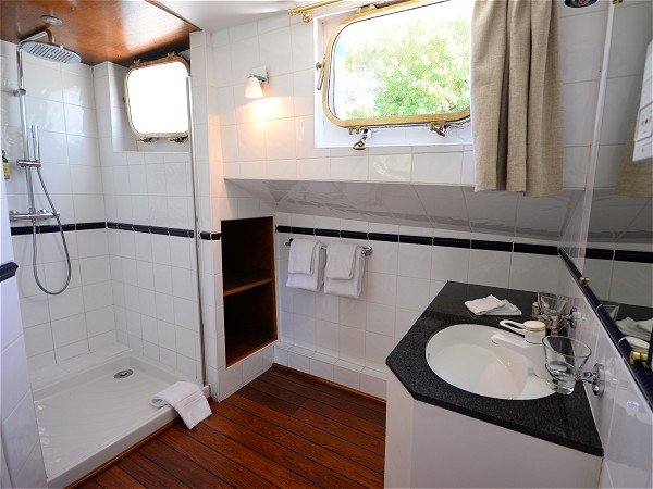 Each cabin aboard L'Impressionniste has its own ensuite bathroom