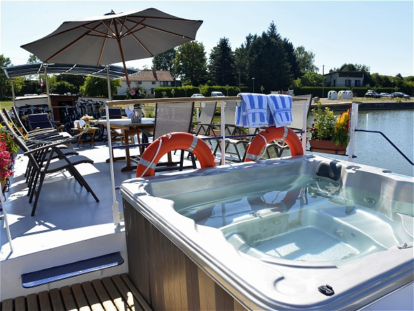 Beyond the spa pool at the bow is a roomy sundeck which offers a canopy<br>for extra shade aboard L'Impressionniste<br> where you can dine alfresco