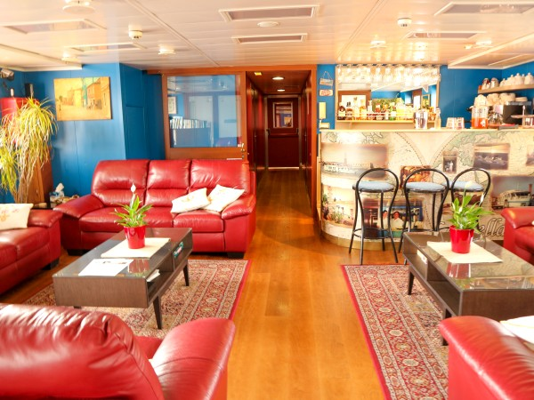 The bar and salon aboard La Bella Vita