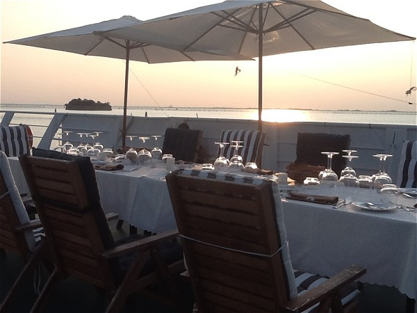Enjoy dining alfresco on the sundeck aboard La Bella Vita