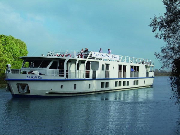 The 20-passenger First Class hotel barge, La Bella Vita cruising on the Bianco Canal, between Venice and Mantua