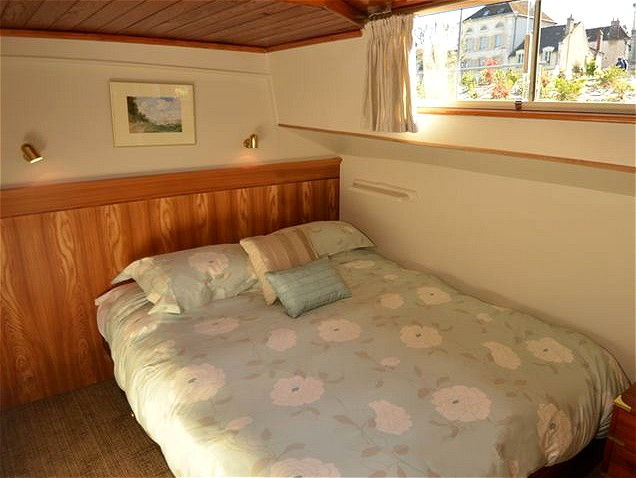 The cabins aboard the Luciole offer either double beds or fixed twin beds for passengers