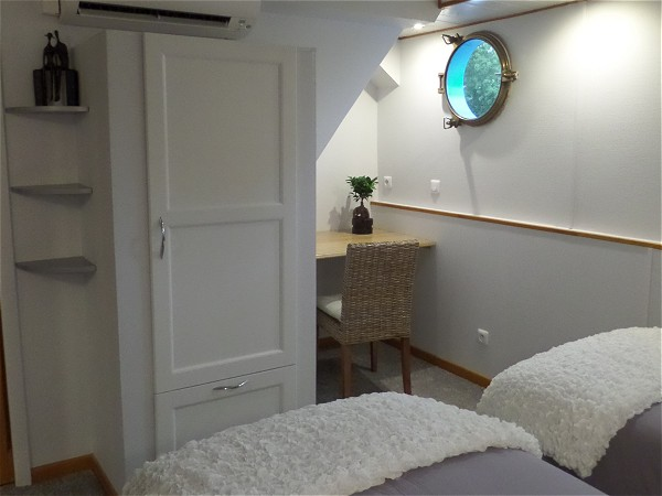 Ample storage and a writing desk in the suite of the barge Magnolia.