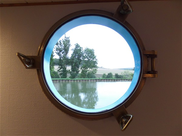 The unique view of the Canal de Bourgogne from your cabin's porthole.