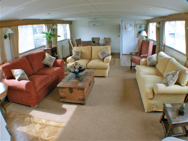 The spacious and sunny salon aboard the meanderer offers comfortable areas to<br> catch a movie or read a book