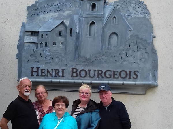 Barges In France owner, Sally Dillin and other guests enjoying Meanderer's excursion<br> and wine tasting at Domaine Henri Bourgeois
