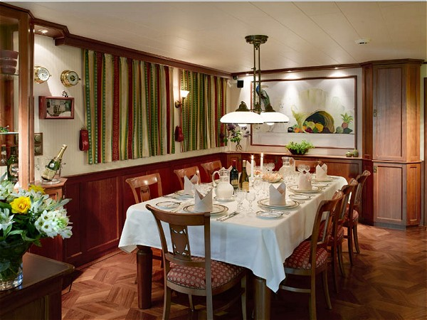 The elegant dining room aboard La Nouvelle Etoile is the perfect setting for every meal