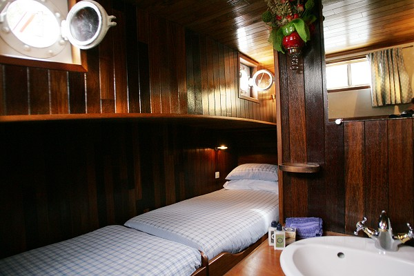 Chambord twin cabin, about 107 square feet, with twin beds end-to-end.  Cabin is on same level as main salon and dining.