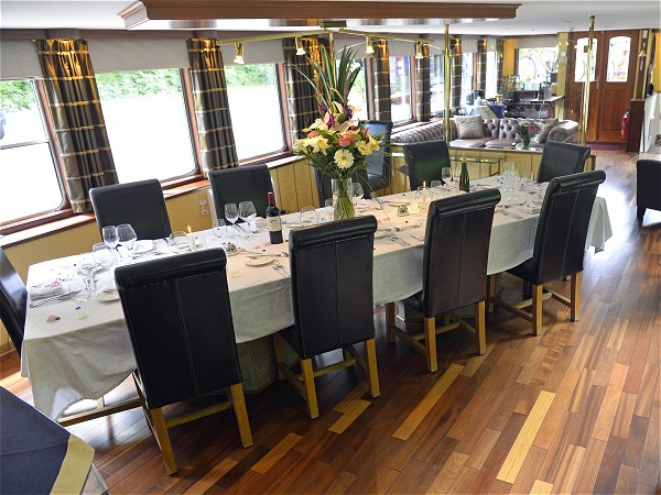 The spacious dining room is always beautifully set for every meal