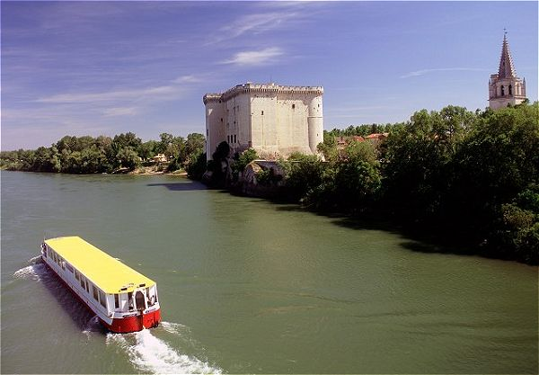 Le Phenicien Cruising the Rhone in Provence, passing the Castle at Tarascon on the right.