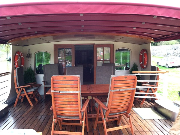The canopied sundeck with comfortable seating aboard the Prosperite