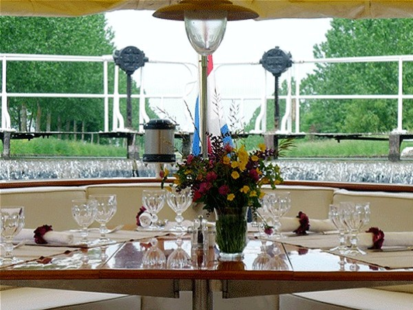 The canopied section of the deck at the stern of the Roi Soleil is perfect for alfresco dining