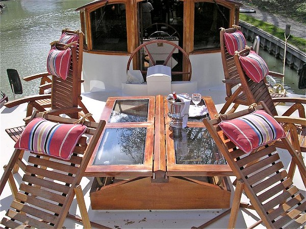 The sundeck at the bow of the Roi Soleil offers a sitting area that is adjacent to the wheelhouse