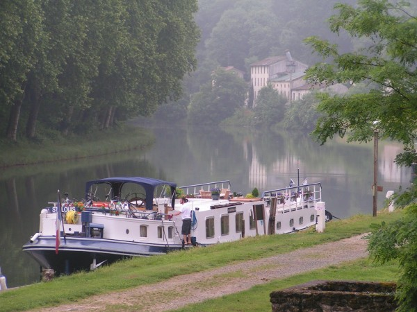 Saint Louis moored in the early morning near Castets-en-Dorthe at the start of the Canal Lateral a la Garonne.