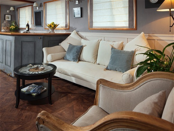The cozy salon aboard the Saint Louis offers comfortable seating
