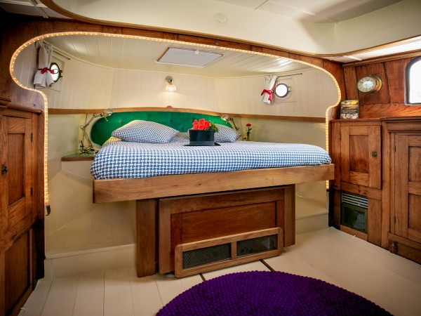 The original captain's aft berth on the Saraphina now converted to a guest cabin with a classic nautical feel
