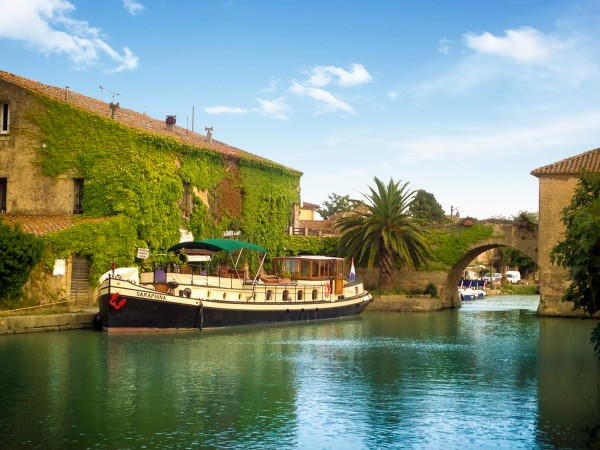 The 4-passenger First Class hotel barge Saraphina, cruising on the historic Canal du Midi