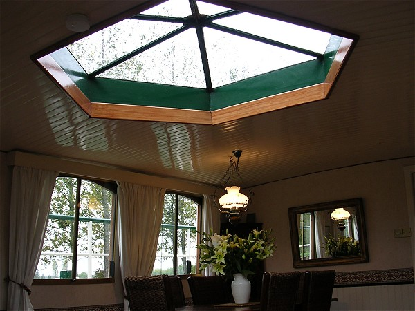 The lovely architectural skylight over the dining area aboard the Saroche